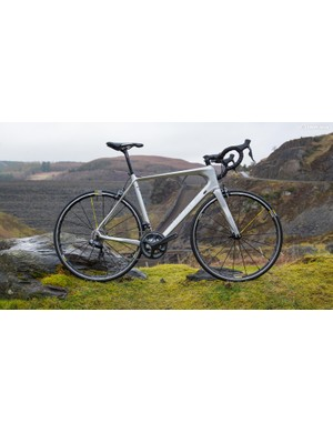 This Ribble road bike features a compact frame with a sloping top tube