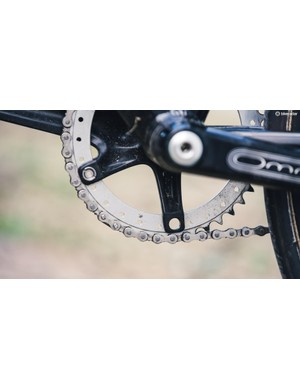 Yes, that is a missing chainring bolt and no, it's not for weight savings...