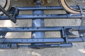 Notice the mounting holes – offsetting the trays keeps handlebar and seat interference between bikes to a minimum
