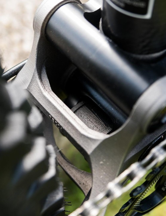 The delicate chainstay brace is a work of art, designed by high-tech software