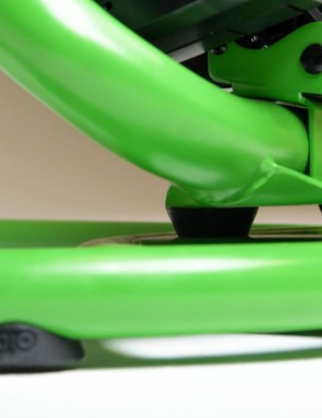 The trainer pivots side to side on elastomers
