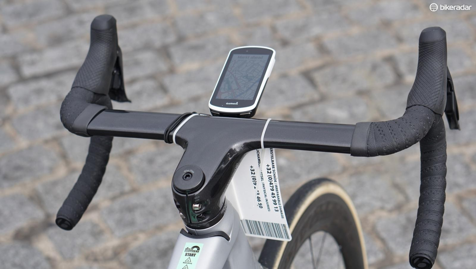 An integrated aero bar/stem wouldn't be my first choice for cobbles, but the Madone set up really isn't bad