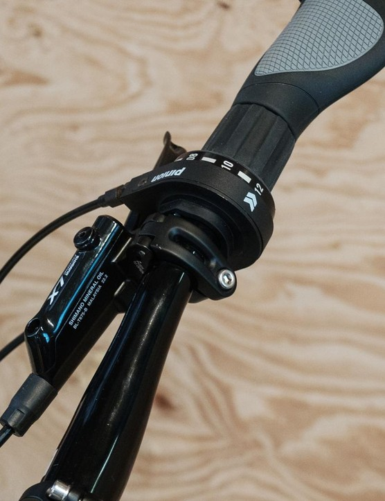 The gears are selected by a nicely machined GripShift style shifter