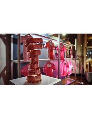 The trophy for the 100th Giro sits proudly in front of the pink jerseys of some of the race's most famous winners