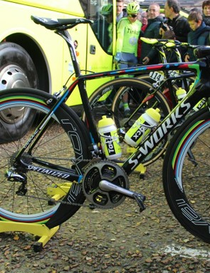 Note how all his teammates' bikes have numbers on them before the start