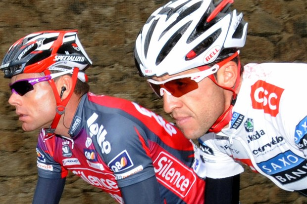CSC's Carlos Sastre, right, rides with fellow yellow jersey contender Cadel Evans of Silence Lotto earlier today