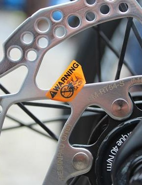 How new are disc brakes to the pro peloton? So new that mechnics haven't yet pulled off the safety stickers