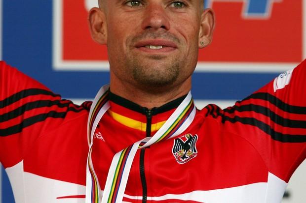 Stefan Schumacher celebrates his bronze at the world's