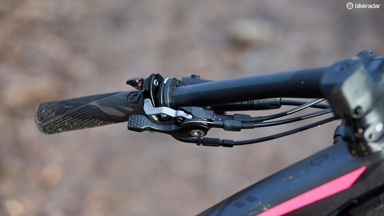The cockpit feels clutered with both lock-out levers for front and rear travel as well as the dropper control