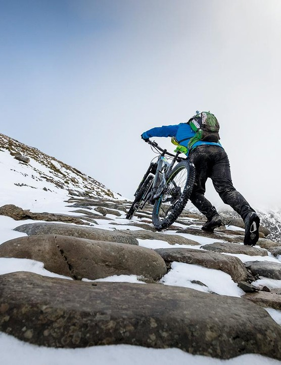 Pushing an e-bike up a snowy slope is not much fun