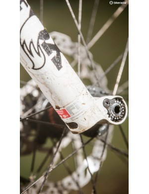 The lightweight, race bred Fox 32 fork has cutaway segments in its hollow leg tips as well as a neat remote compression damping adjuster