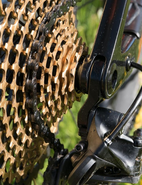The alloy derailleur hanger is sandwiched between the carbon frame, helping drop weight