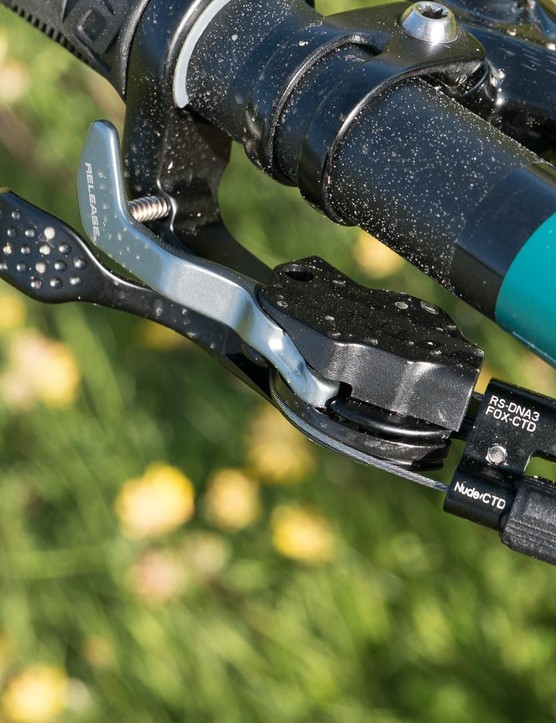 Scott's Nude system gives you on-the-fly travel adjustment of the rear shock and also alters the fork's compression damping at the same time