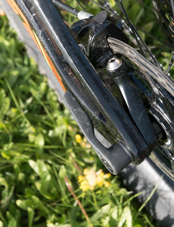 The disc brake is mounted onto an alloy carrier that attached to the chainstay and axle, allowing the seatstay to flex
