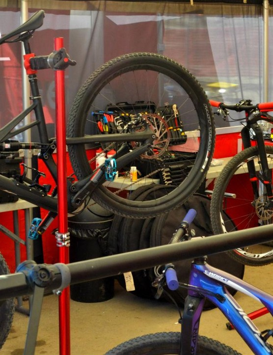 Under the big red tent, Specialized bikes are waiting for the final check over, eager for go time