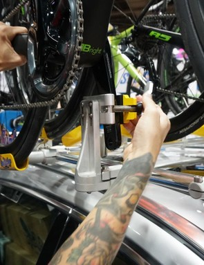 A sturdy quick-release holds a complete bike on the roof for fast access by pro mechanics