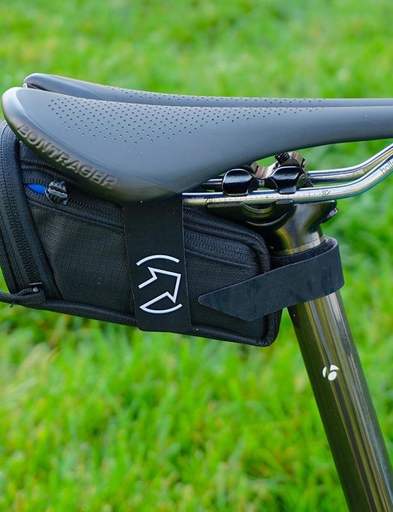 Tucked on the drive-side of the bike is a perfectly placed multi-tool storage stash