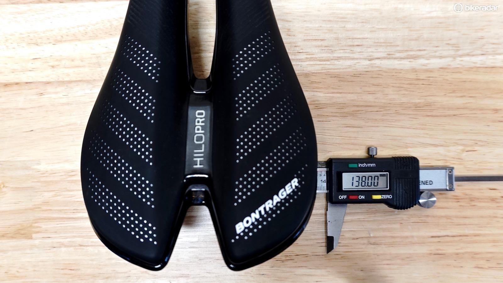 This saddle is 138mm but is made for cyclists in a very aggressive front-end position, resting on the pubic rami (which are more narrow than ischial tuberosities)