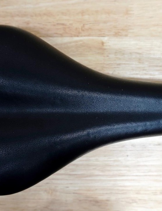 This saddle has tons of soft padding but results in midline pressure