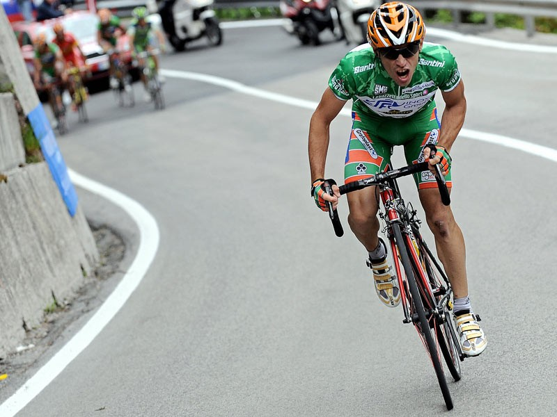 Italy's Emanuele Sella leaves behind him the pack during the 15th stage of the 91st Giro d'Italia from Arabba to Passo Fedaia on May 25, 2008. Italy's Emanuele Sella won the stage
