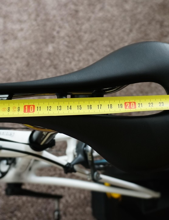 Measure the full length of your saddle to find a midpoint - this Selle Italia is 27cm (13.5 midpoint)