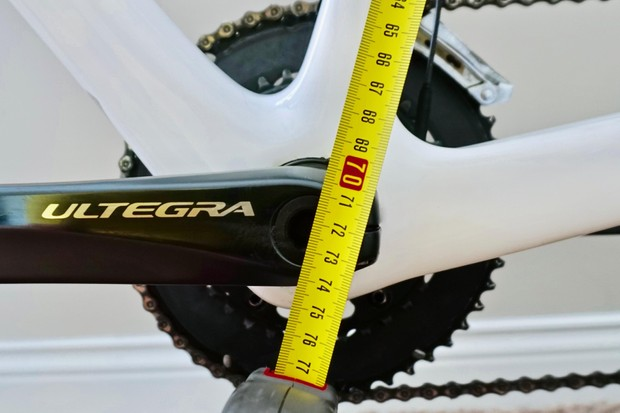 From the mark on the saddle to the center of the crank - measure to the millimeter and use the side that provides the most accurate measurement (drive side vs non-drive side)