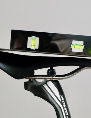 Measuring saddle tilt with a clipboard provides an overall angle, eliminating any deviations due to saddle contours - smartphones work great for this, but make sure your bike is level