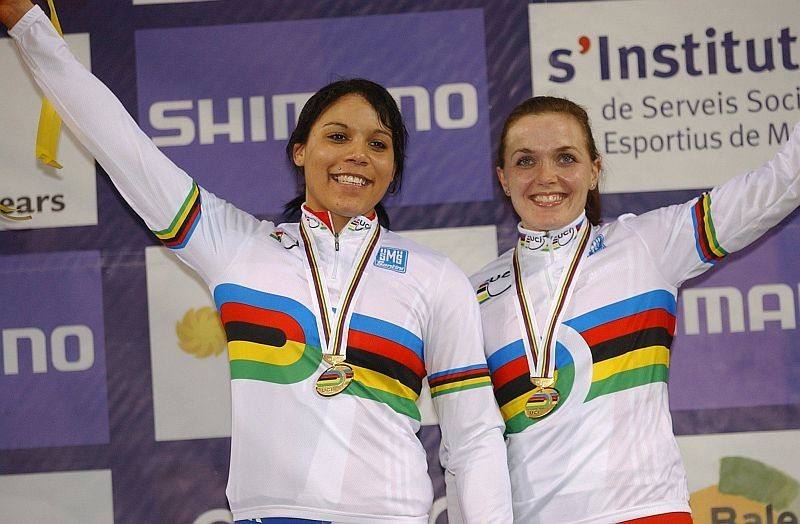 Shanaze Reade (left) and Victoria Pendleton celebrate World Team Sprint Gold