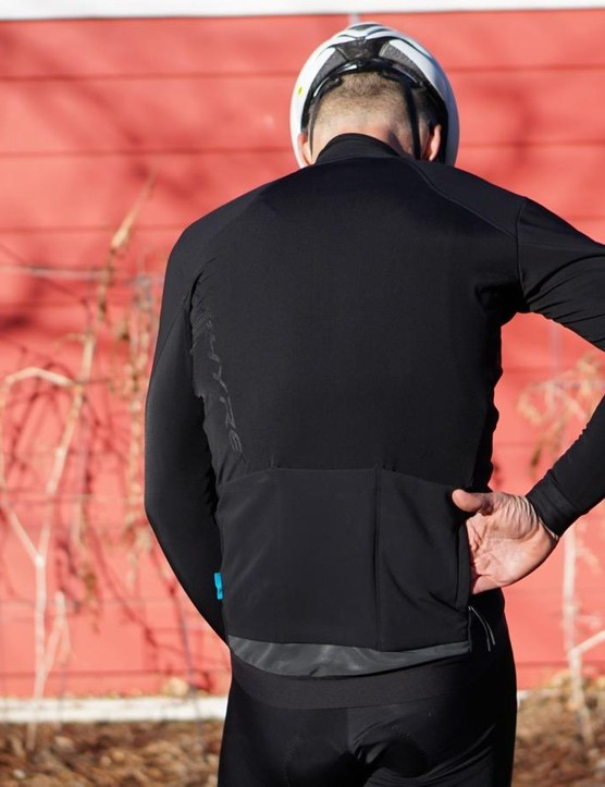 As we're seeing more of these days, the winter jersey has a zippered side pocket in addition to the standard three, plus a wide reflective swath along the tail