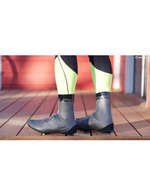 The tights' lower legs fit snugly underneath booties