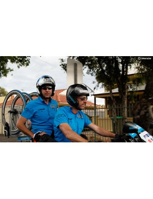 Feeling the heat of the day, Belgium's Tom Claes (driving) and Patrick Dils provide support from the bike. Claes is a motorbike police officer back home, while Dils is a wiper blade consultant at Bosch