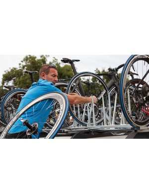 There's already a stack inside the car, but more spare wheels are loaded up among the bikes