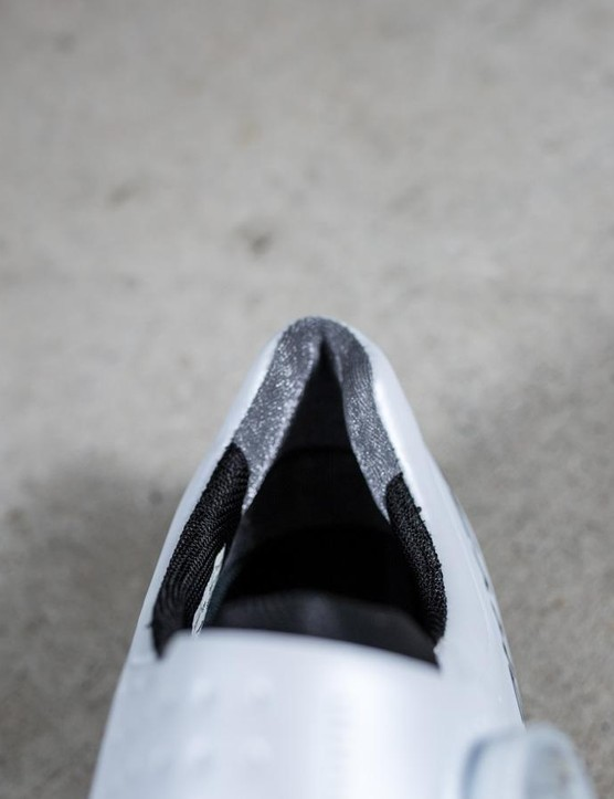 The heel of the shoe has one-way silver fabric