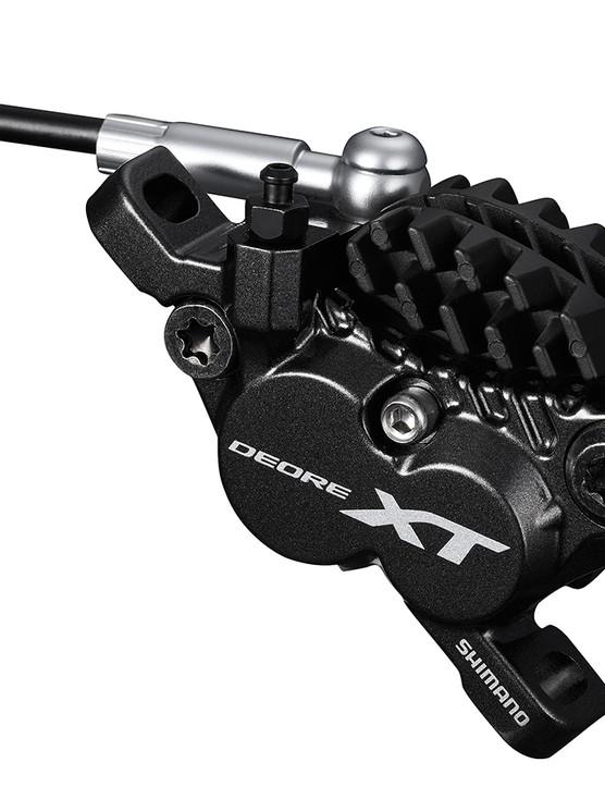 A four-piston brake caliper is back in the Shimano XT family