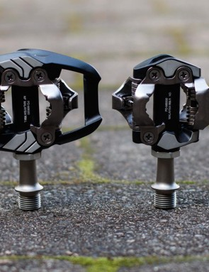 A comparison of the Shimano XT M8020 Trail next to the lighter XT M8000 Race pedal