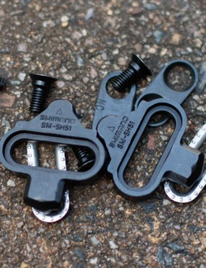 Both pedals use Shimano long-time SPD cleat. It's a proven design, that few have managed to match after all these years