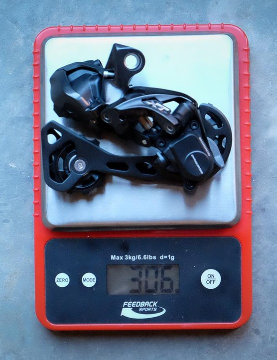 The rear derailleur weight is 306g* Note that this derailleur was weighed without the B-knuckle and fixing bolt installed. The actual weight with the B-knuckle installed (required for non-direct mount frames) is 329g