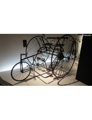 The Starley Sociable trike from 1879 used side by side seating, to make it sociable to ride. The differential drive was patented by Starley and it's the same as that found on the Salvo