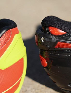 The Pro Leader has a minimal T-shaped heel counter over a semi-flexible heel. The Shot's molded heel cup is solid all the way around