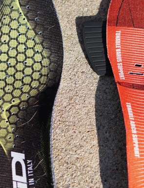 The Sidi's insole (at left) is flat and plain. The PRO Leader comes with inserts for the arch and forefoot