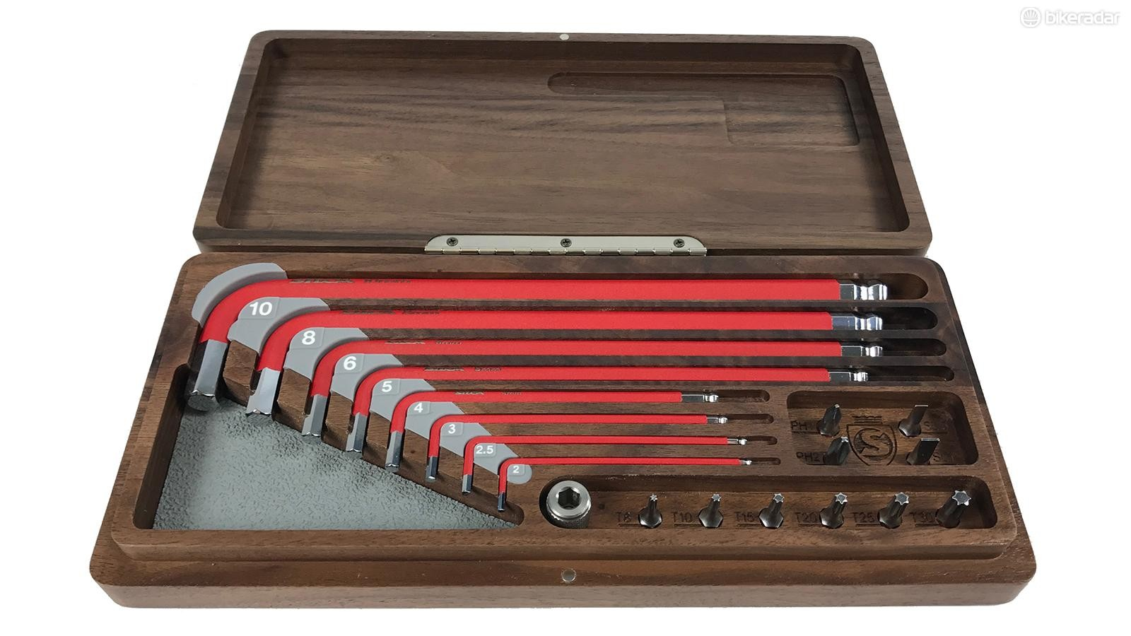 The limited edition has the same tools as the standard kit, housed in a walnut box