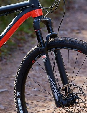 The Recon fork isn't that light but has a 15mm axle and remote lockout