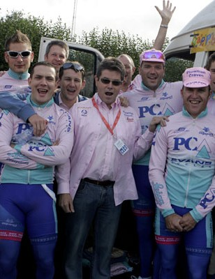The  team help Simon  Barnes, team founder and CEO of  Plowman Craven celebrate his  birthday