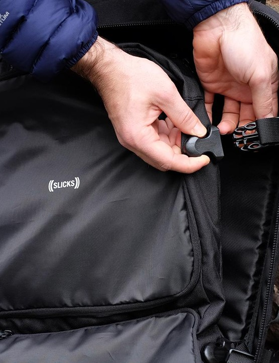The Tripcover fits neatly into the main compartment with buckles to secure it into place