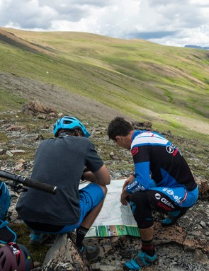 Checking maps with Giant pro rider Adam Craig