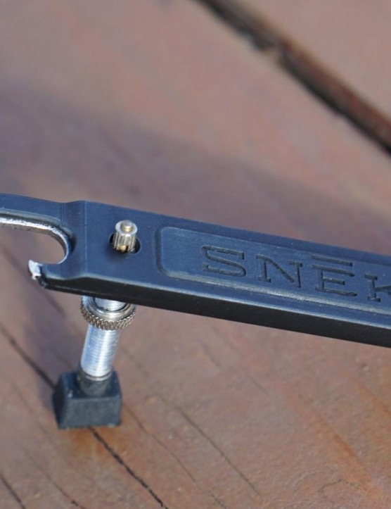 The Snēk Cycling Lifeboat Tire Lever is a three-in-one tool