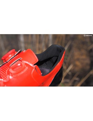 The heel cup is also lined with a grippy material that further grabs on to your foot and won't let go