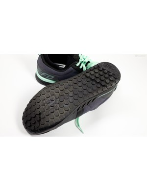 The sole features a raised tread pattern with a deeper tread at the toe and heel for increased traction