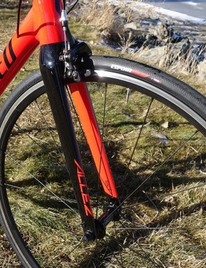 The all-carbon fork looks great and keeps weight on the sub-$800 bike low. Front fender mounts at a touch of practicality