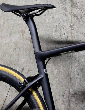 An integrated seatpost collar sits within the frame